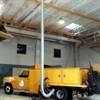 Overhead roll vehicle exhaust shop ventilation