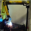 Welding fume swing arm exhaust hose system